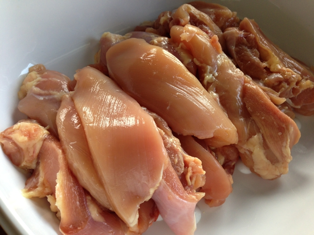 Raw chopped boneless chicken thighs
