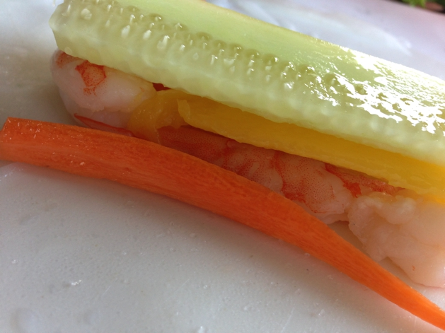 Begin to layer mango and all other vegetables on top of shrimp.
