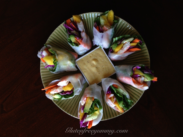 Slicing the spring rolls on an angle makes for a burst of color.  Dipping them in the spicy-mango sauce makes for a burst of flavor!
