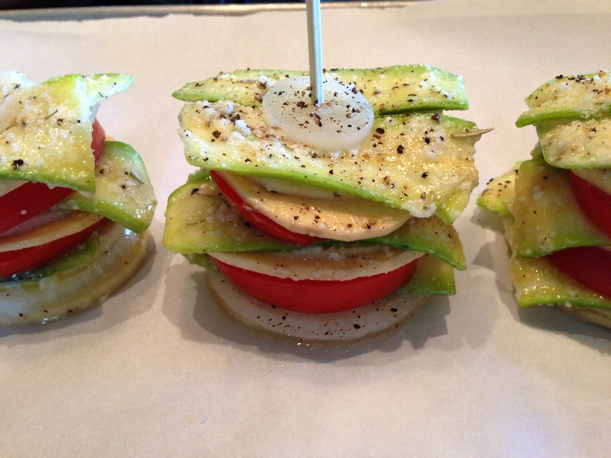 Evenly stack alternating veggies and spear them with a skewer to hold them together during the baking process.