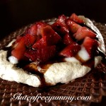 Meringues with fruit and honey balsamic sauce