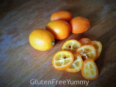 Colorful sliced kumquats are tart on the inside and sweet on the outside.
