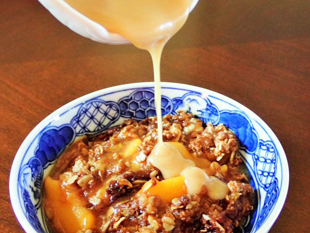 Drizzling Maple-Rum Cream over Peach Crisp