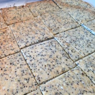 Sliced three seed grain-free crackers